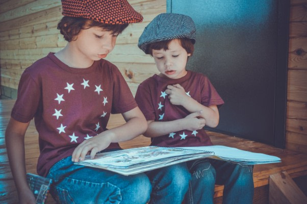 2 kids with a book